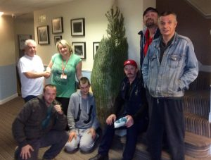 Voicing CSA Chair, Phillip Lafferty presents a Christmas Tree to staff and residents at The Falcon Centre.